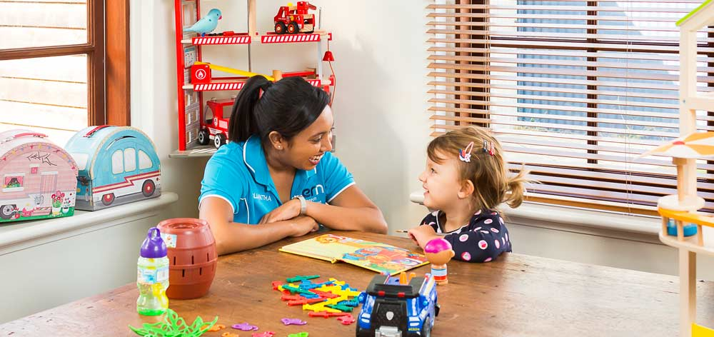 Therapist working with child